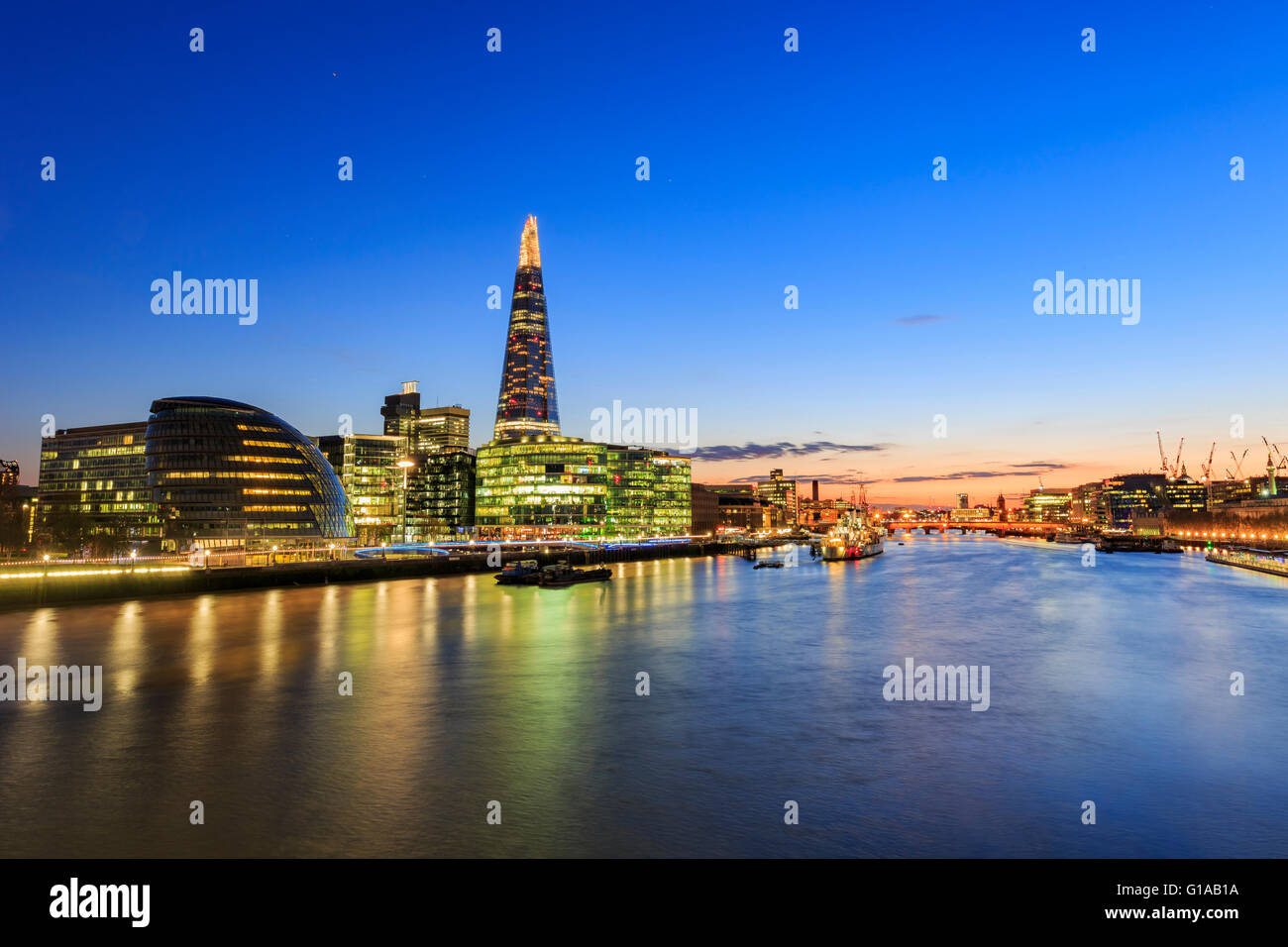Some nightscape around the Thames River at London, United Kingdom - Stock Image