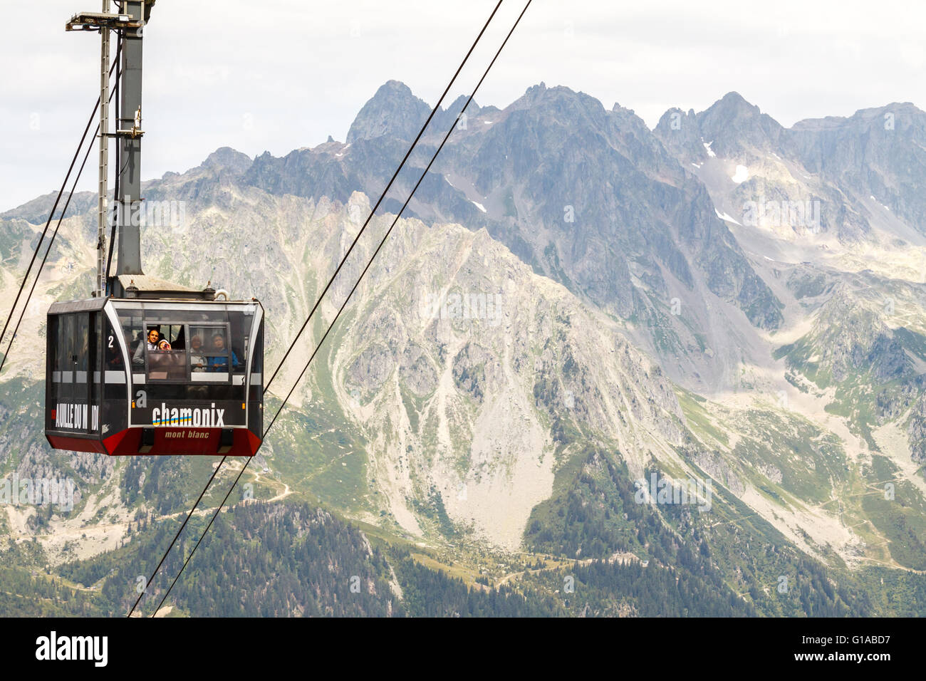 people in cable car/ lift from Chamonix to Aiguille du Midi on the top of Mount Blanc in France - Stock Image
