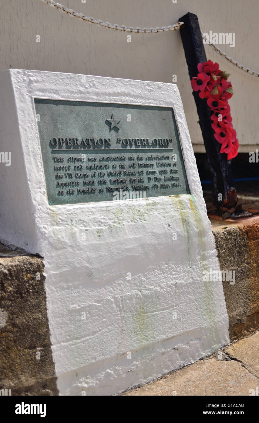 A memorial plaque beside a slipway constructed as part of Operation Overlord in 1944. - Stock Image
