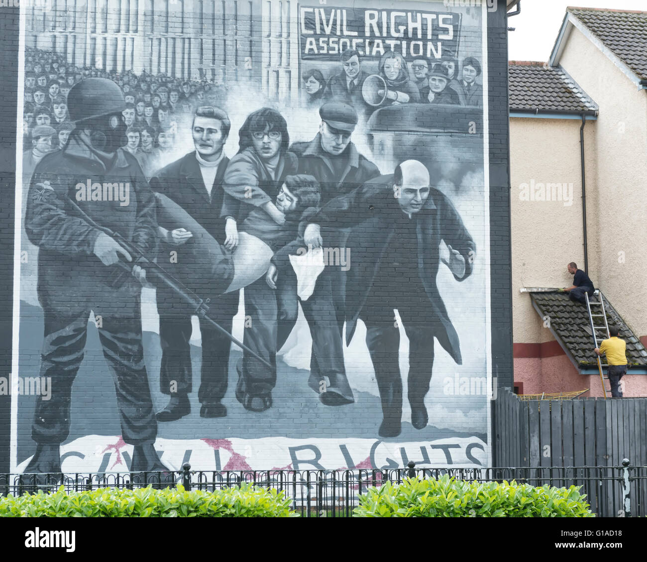 The Bloody Sunday mural showing catholic priest Edward Daly (later to become Bishop Daly) waving a white handkerchief. - Stock Image