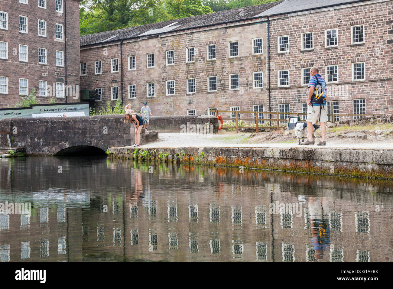 People visiting Cromford Mill, part of the Derwent Valley Mills World Heritage Site, Derbyshire, England, UK - Stock Image