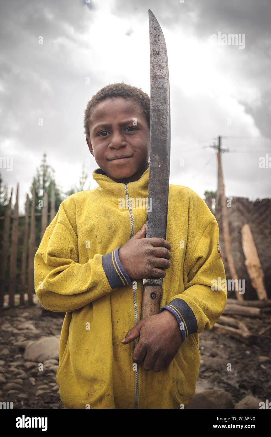 Boy with machete in Mt Hagen, Papua New Guinea - Stock Image
