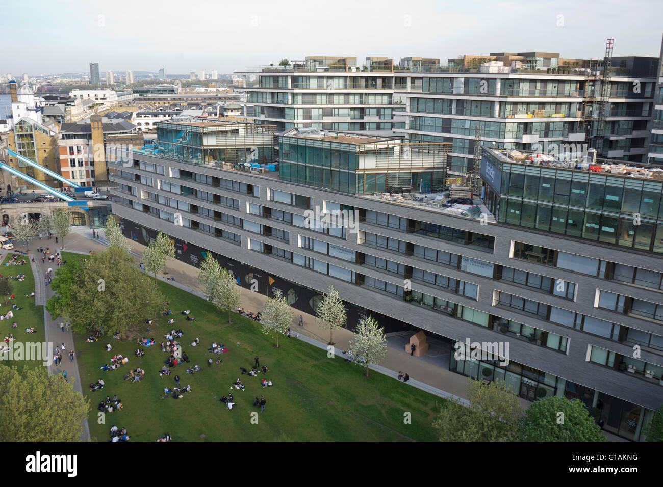 Views of Tower Bridge and new luxury housing developments near City Hall, London, UK - Stock Image