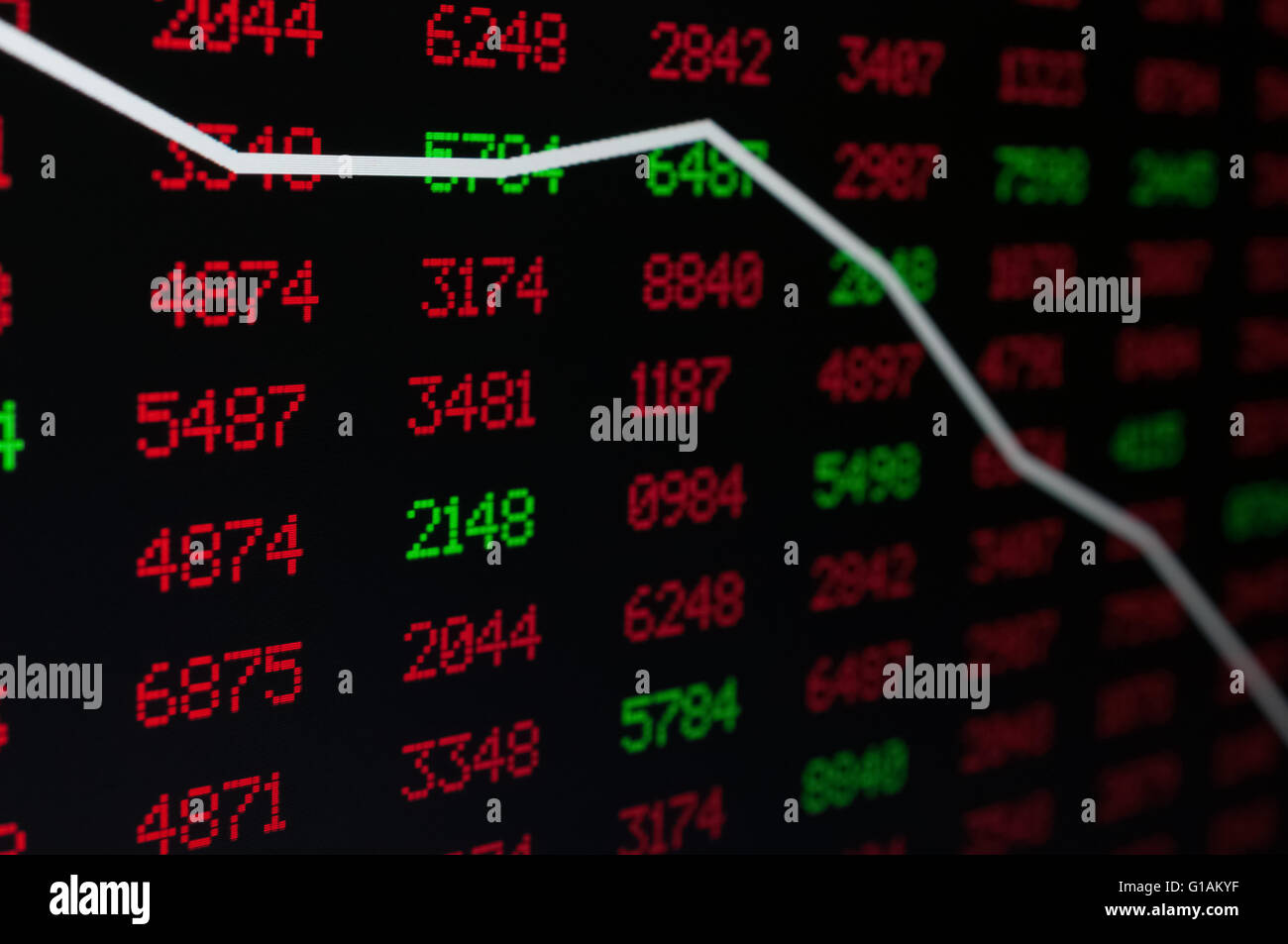 Stock Market - Arrow Graph Going Down on Display With Red and Green Figures - Shallow Depth Of Field - Stock Image