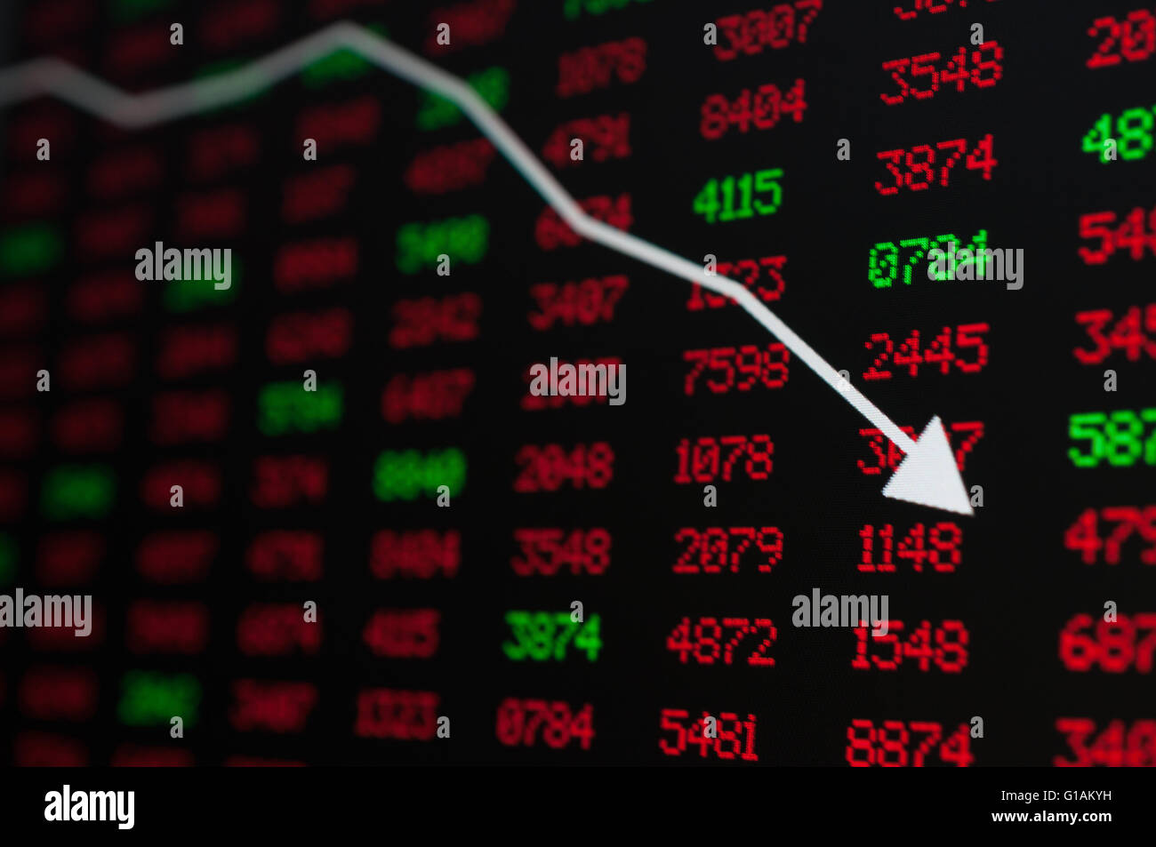 Stock Market - Arrow Graph Going Down on Display With Red and Green Figures - Stock Image