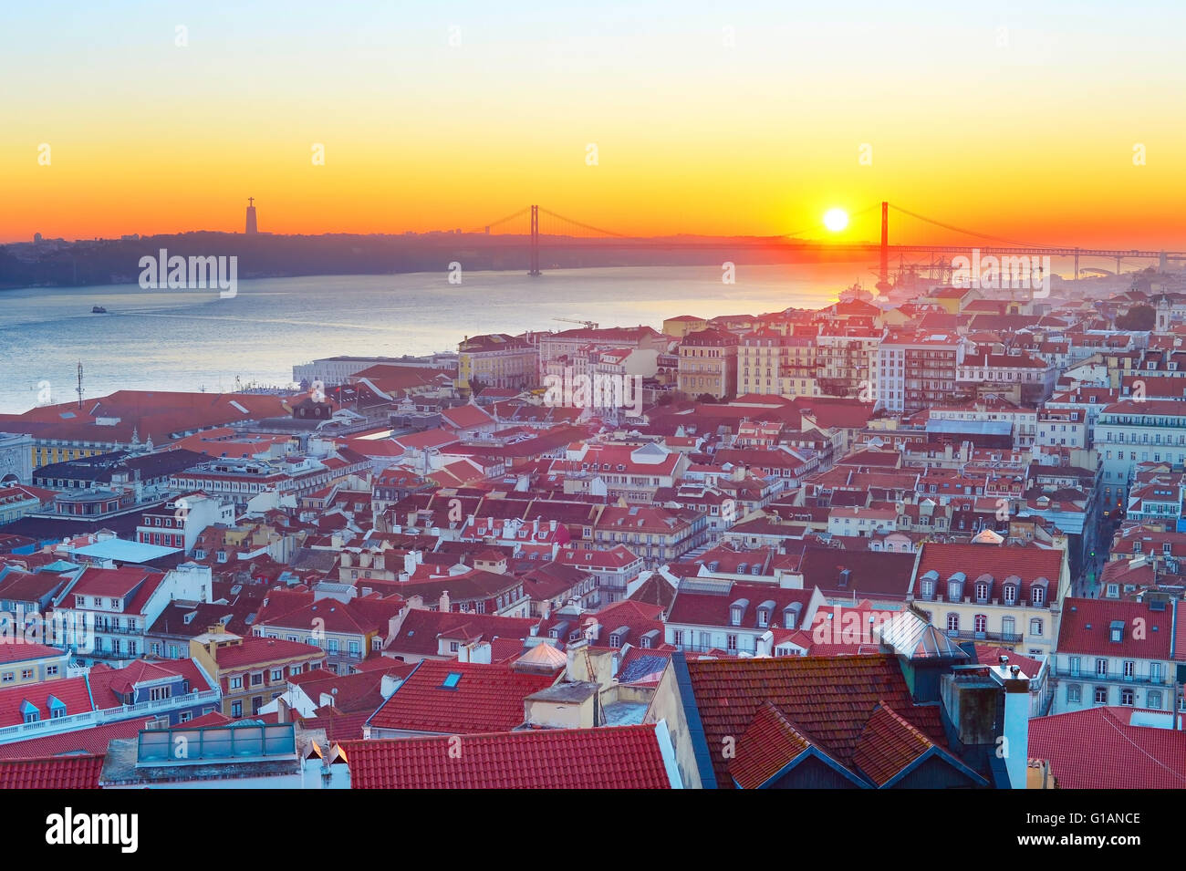 Lisbon cityscape with the sun in the sky at sunset. Portugal - Stock Image