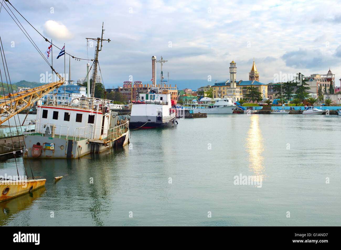 Batumi Sea Port with old and modern boats. Georgian Republic - Stock Image