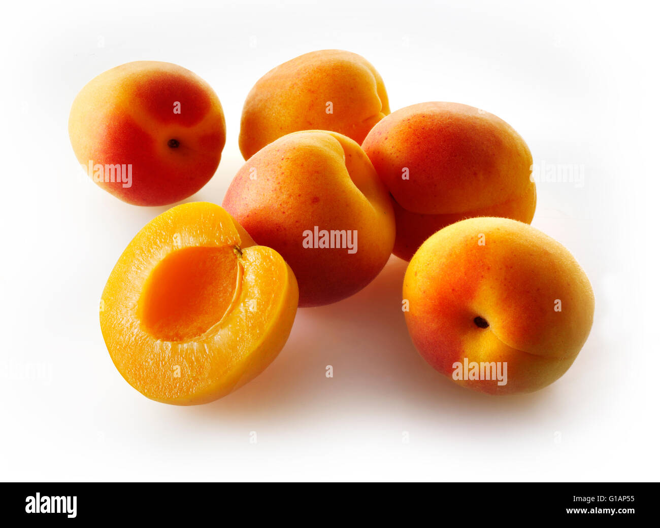 Fresh whole and cut Apricot fruits - white background cut out - Stock Image