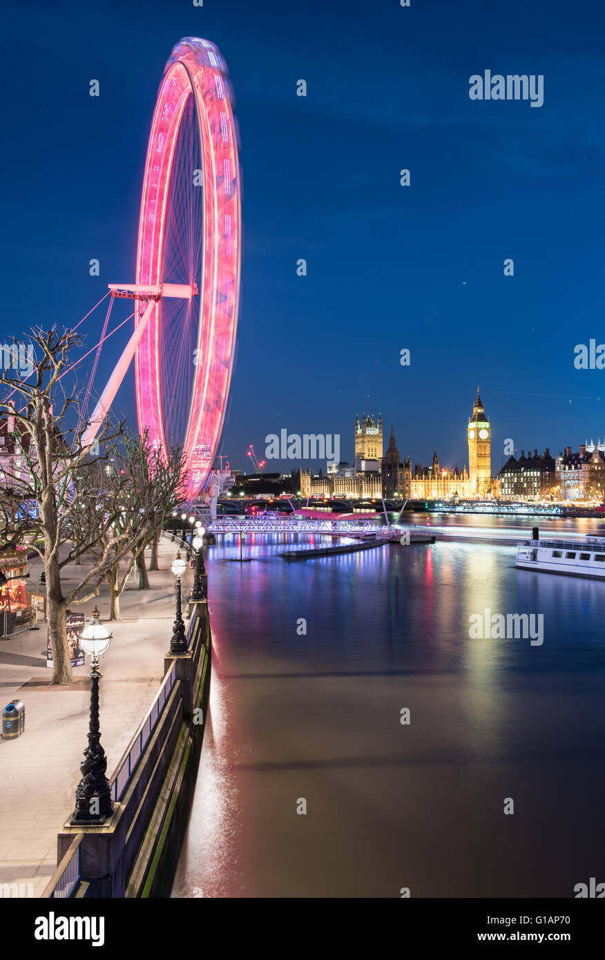 Looking south towards The London Eye and Houses of Parliament at night. - Stock Image