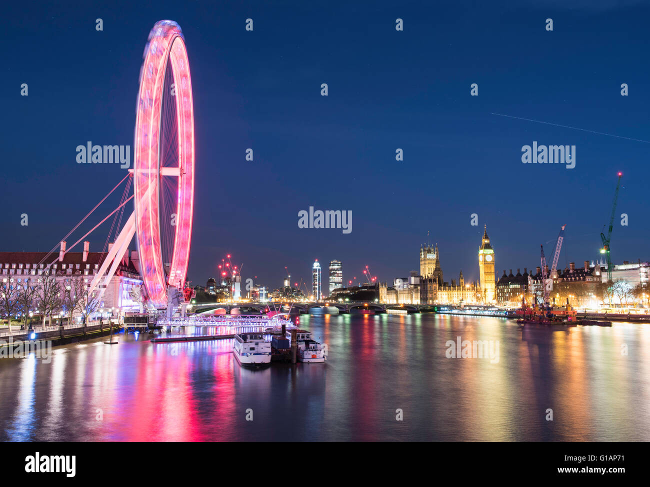 London Eye and Houses of Parliament at night - Stock Image