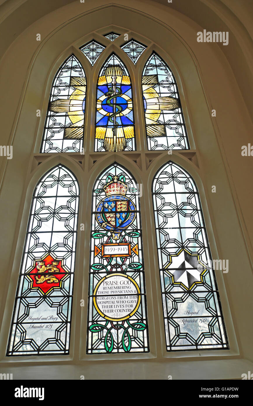 WWII physicians surgeons stained glass memorial window in St Bartholomew the Great church West Smithfield, London - Stock Image