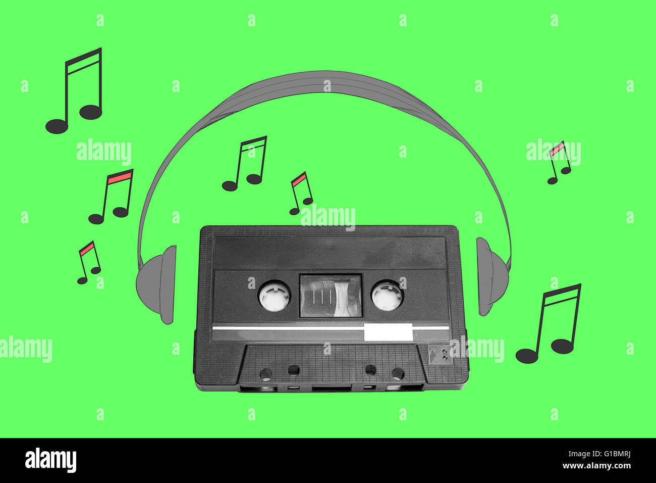 Audiotape and headphone draw on green background - Stock Image