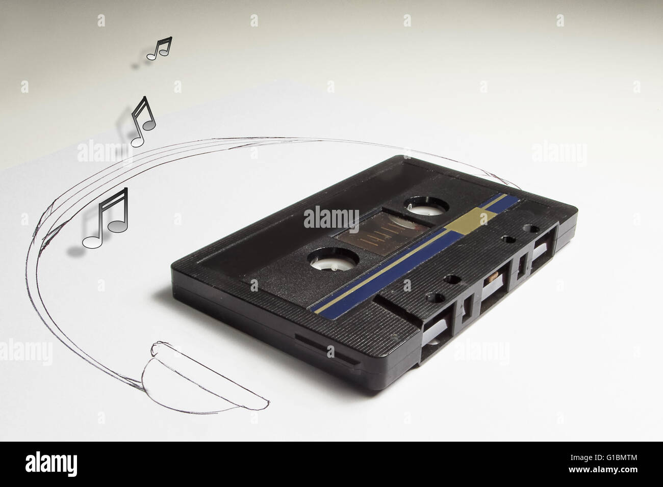 Audiotape and headphone draw on white background - Stock Image