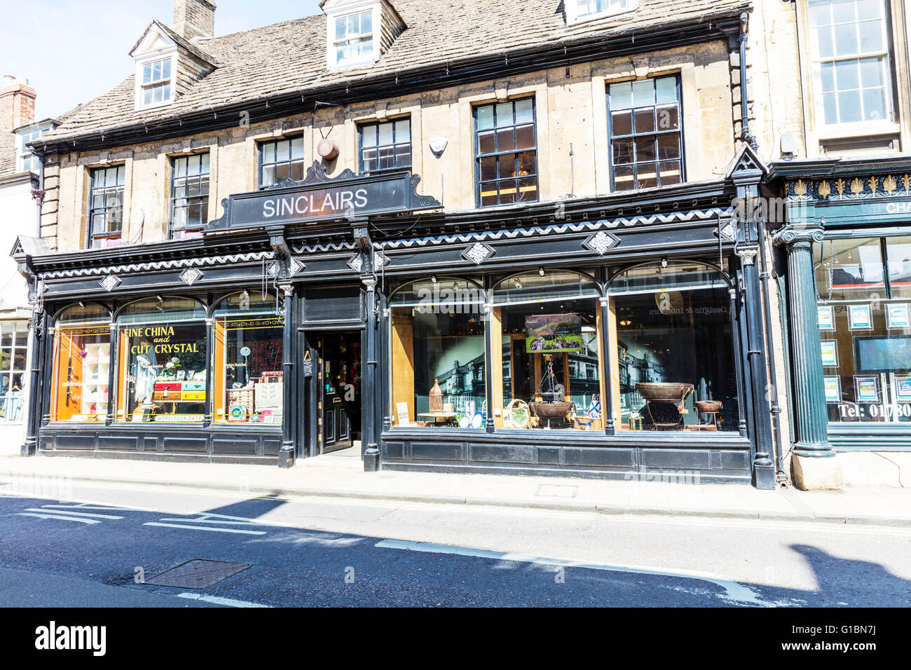 Sinclairs shop old fashioned shops bygones yesteryear shopping Stamford town Lincolnshire UK England English towns - Stock Image