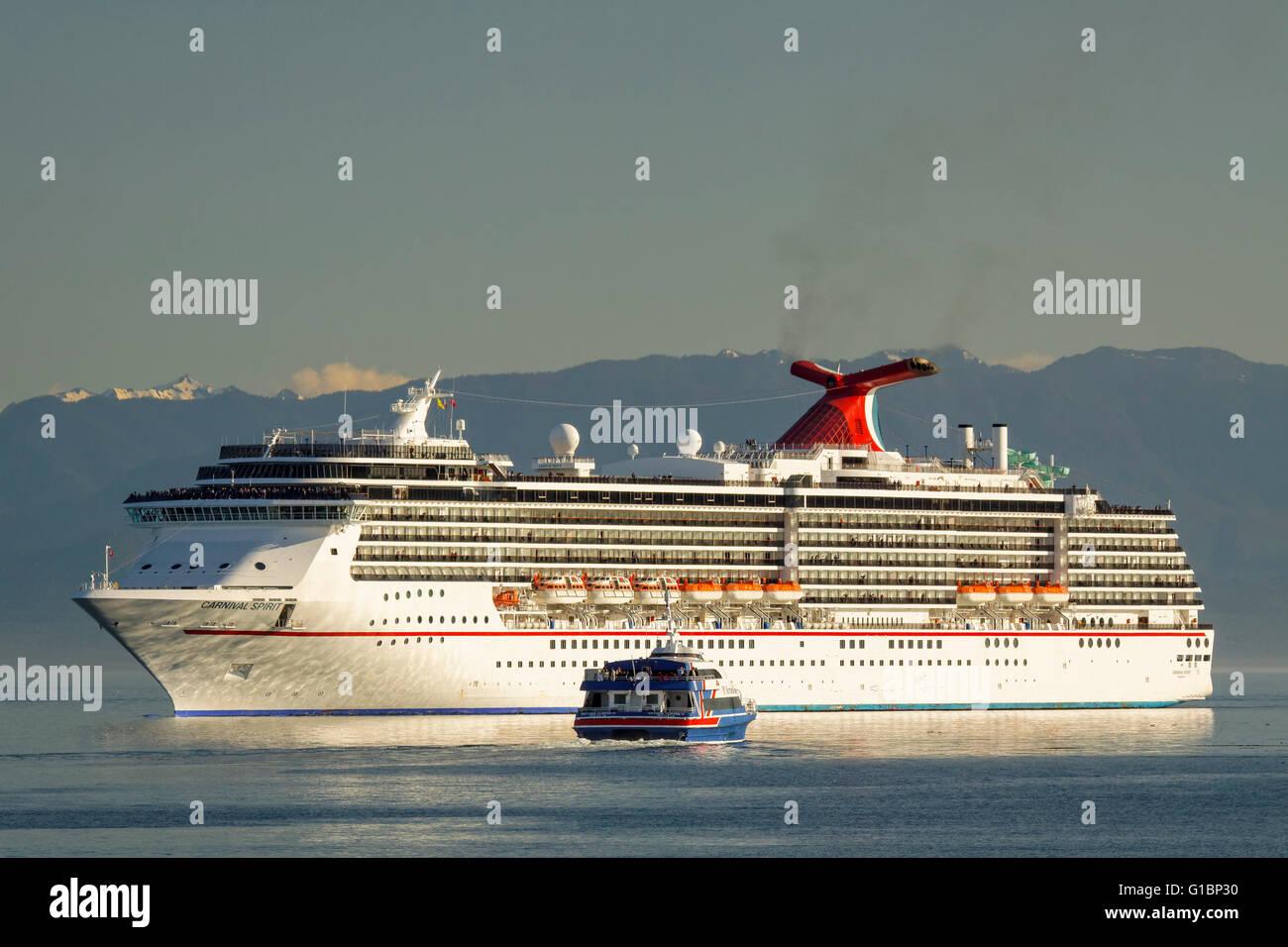 Victoria Clipper ferry and Carnival Spirit cruise ship in Juan de Fuca Strait-Victoria, British Columbia, Canada. Stock Photo