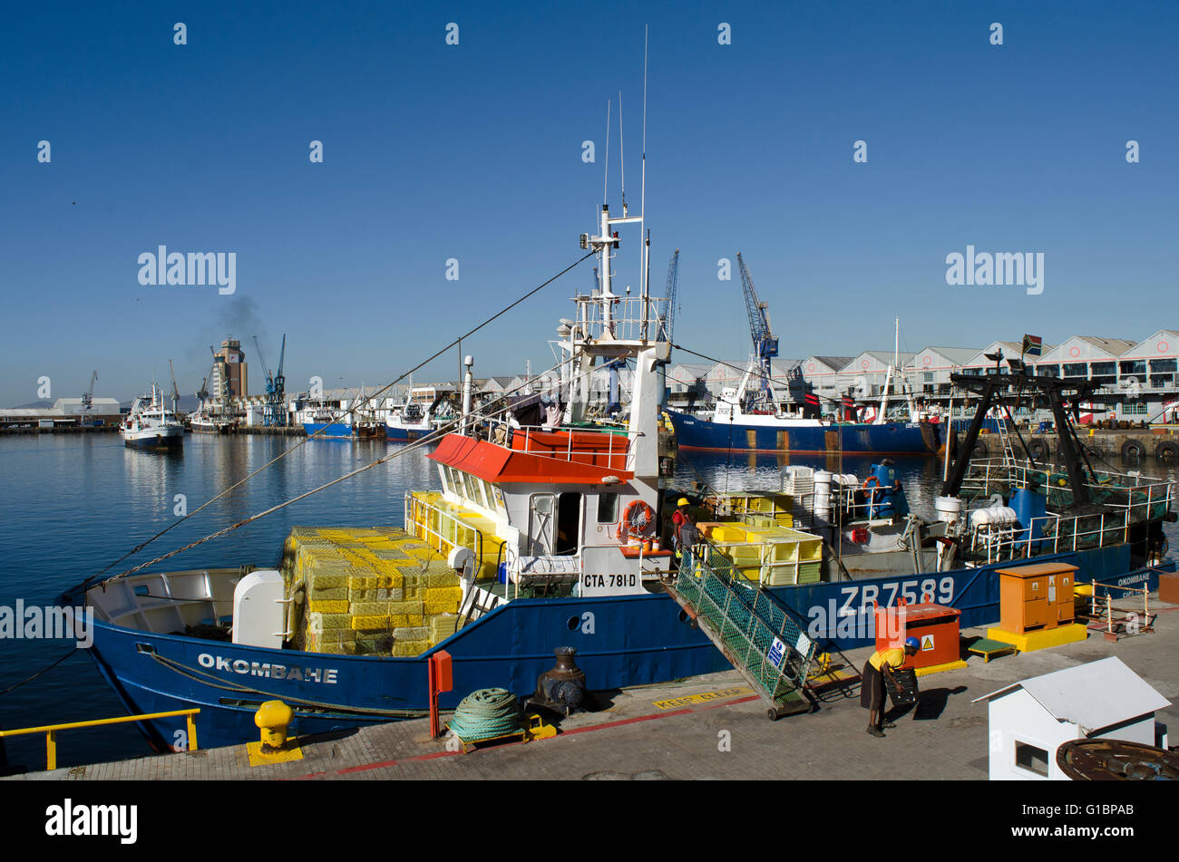 CAPE TOWN SOUTH AFRICA . Fishing boat alongside in the Cape Town harbor with the crew making ready to depart Cape - Stock Image