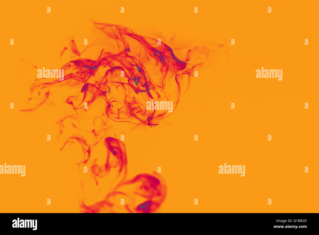 Nice abstraction with smoke in orange and red colours - Stock Image