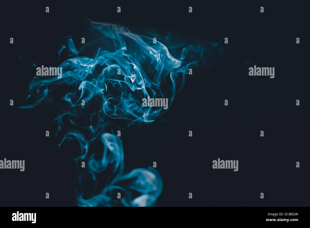 Nice abstraction with smoke in dark and blue colours - Stock Image