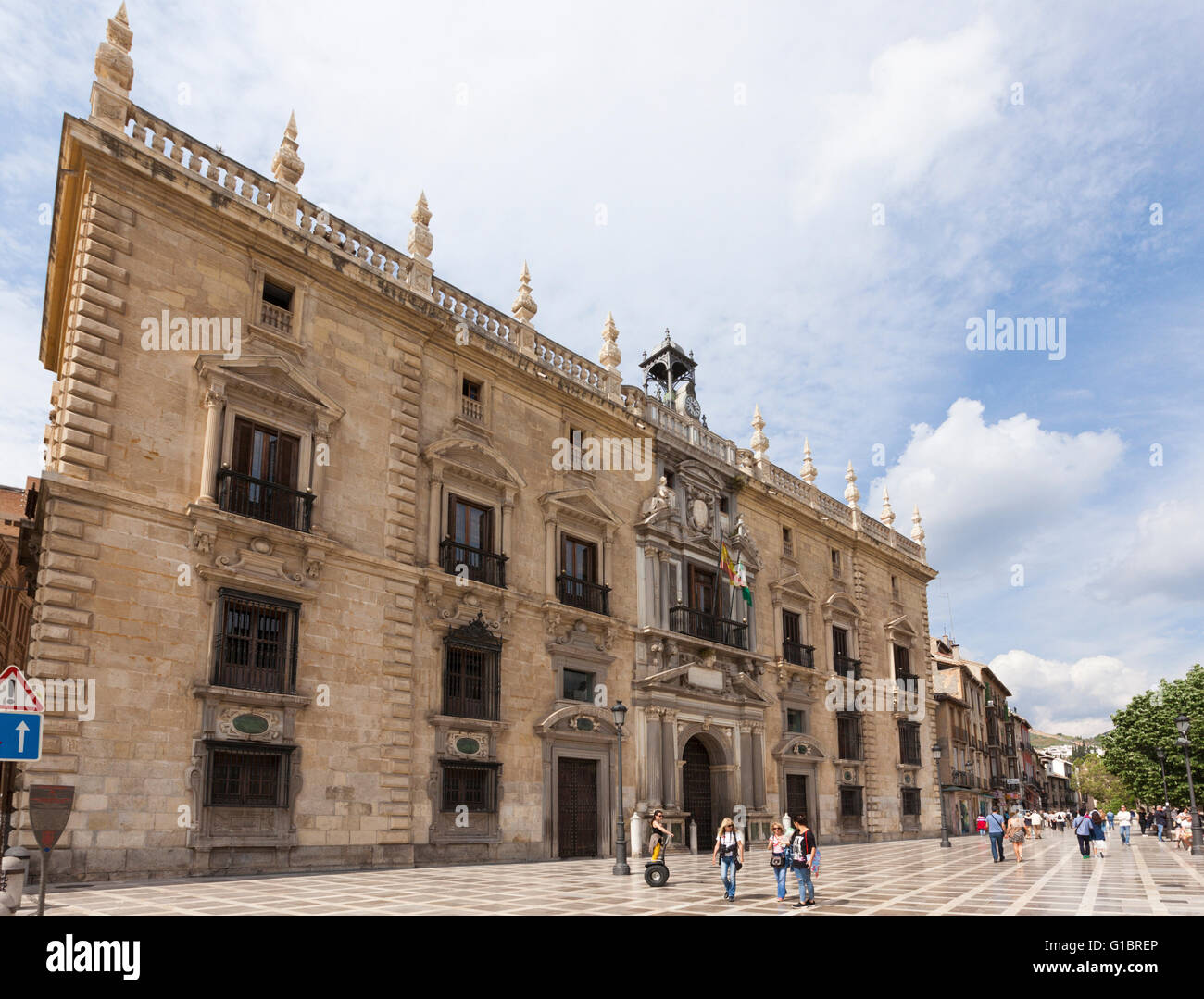 Palacio de la Chancilleria at Santa Ana square, seat of the royal chancery from 1537-1834, tourists passing by - Stock Image