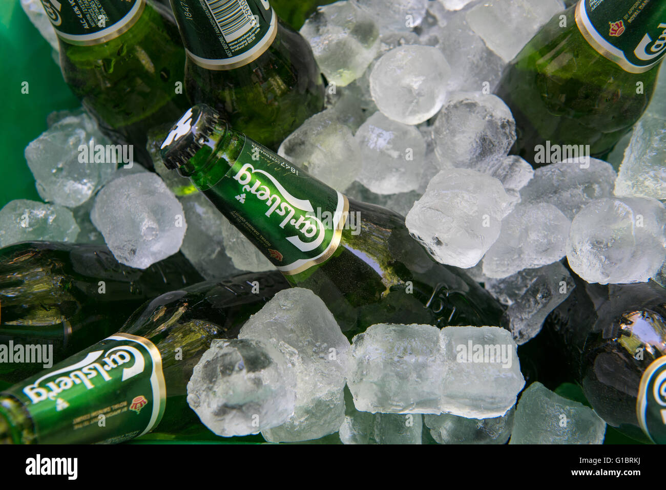 Nicosia, Cyprus - May 7 2016: Small green bottles of famous Carlsberg beer on ice - Stock Image