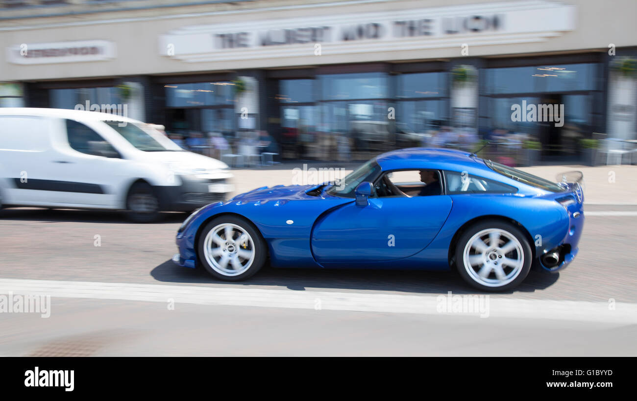 Blue moving TVR on Blackpool seafront, Lancashire, UK. TVR is an independent British manufacturer of high-end sports - Stock Image