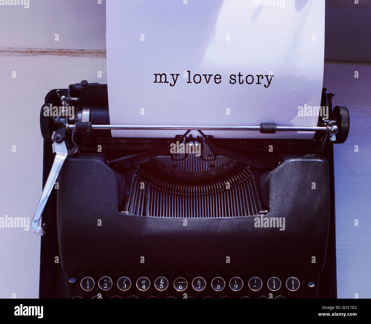 Composite image of my love story message on a white background - Stock Image