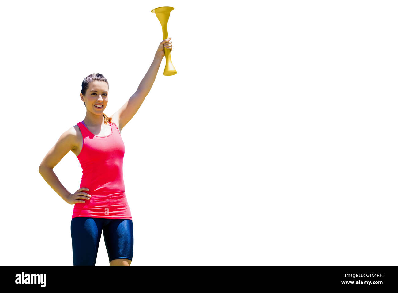 Sporty woman posing and smiling with Olympic torch - Stock Image