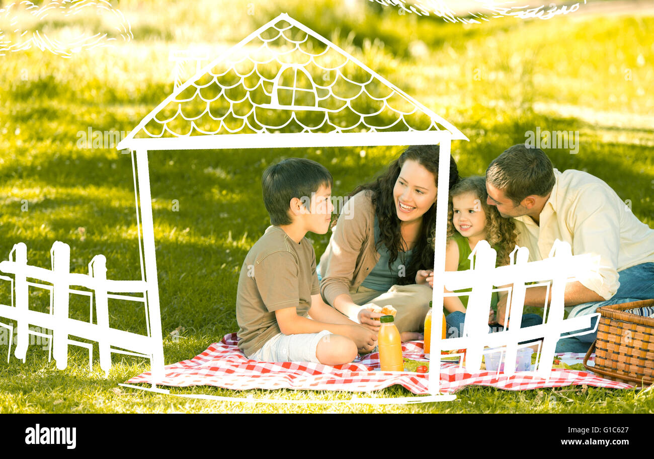 Composite image of family picnicking together Stock Photo