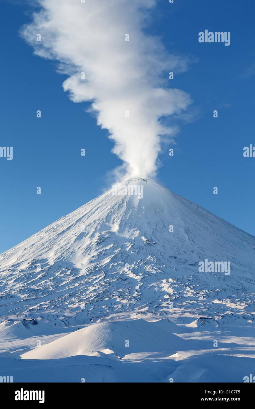 Winter volcanic landscape: highest active volcano of Eurasia - Klyuchevskoy Volcano (Klyuchevskaya Sopka) - Stock Image
