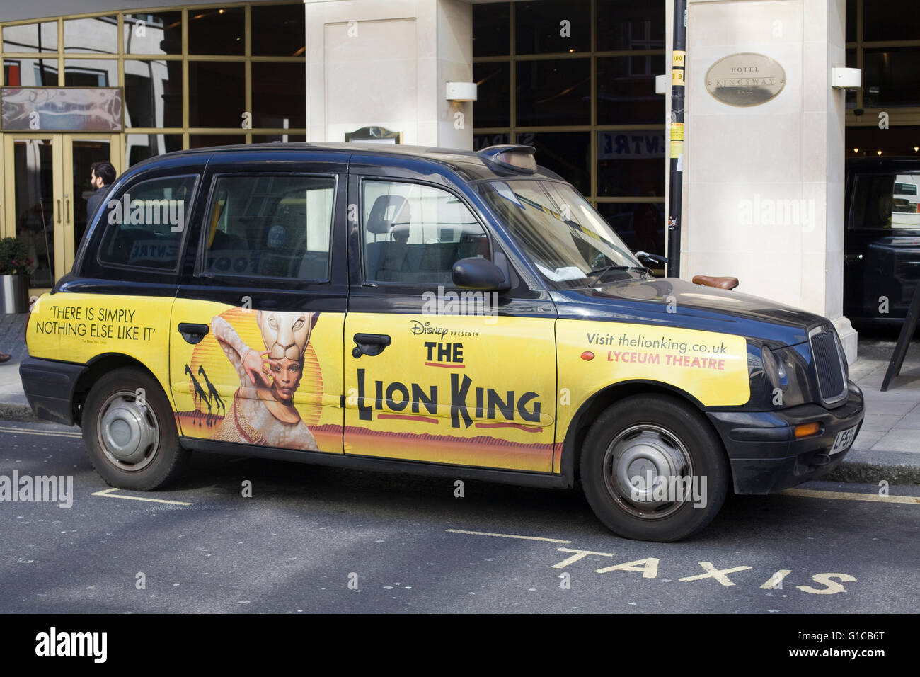 A famous London Black cab advertising The Lion King Stock Photo