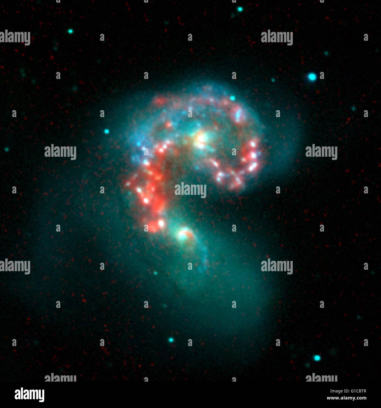 False-coloured image by the Spitzer Space Telescope revealing a hidden populations of new-born stars at the heart - Stock Image