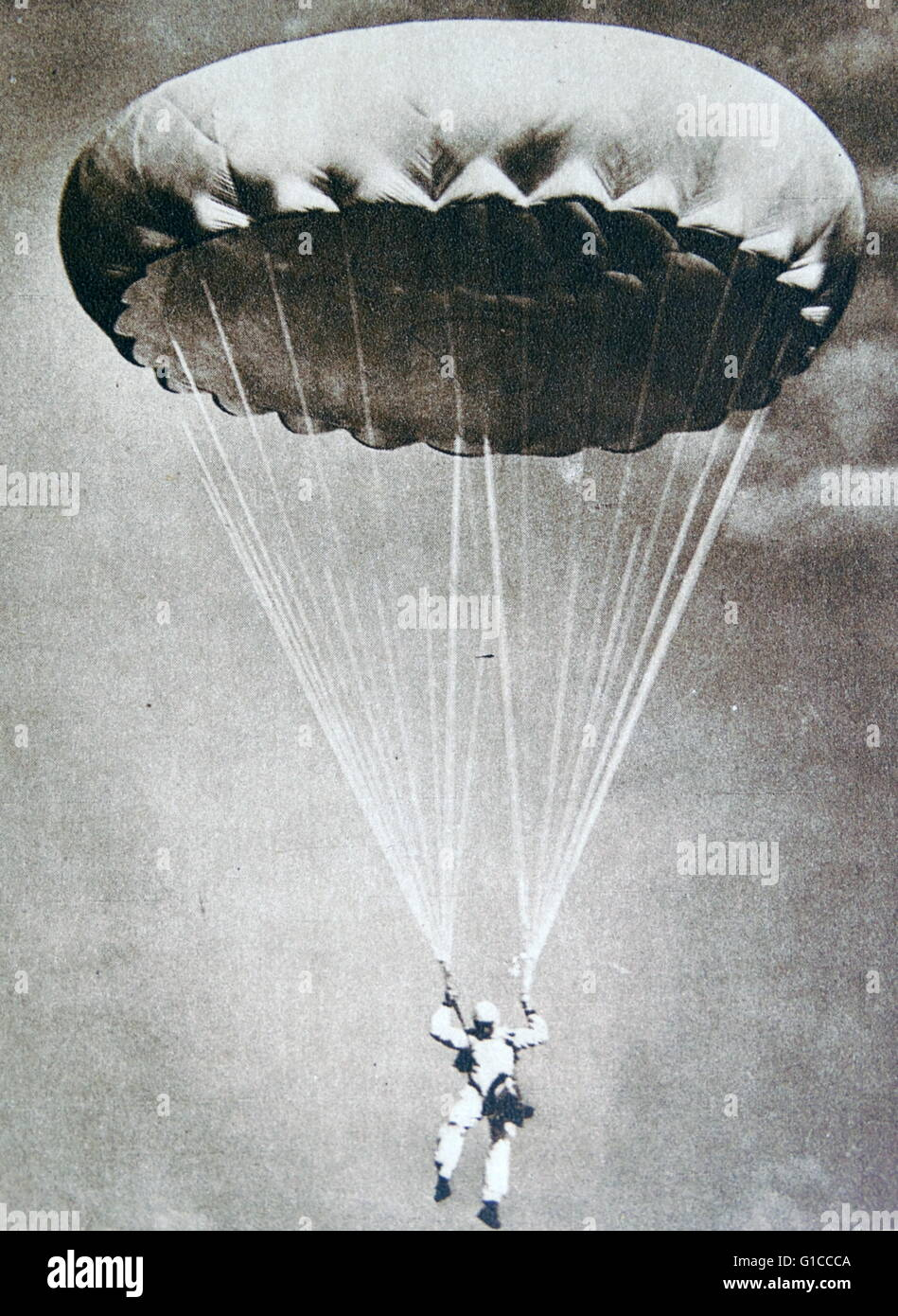 parachutist descends from 8000 feet 1930's - Stock Image