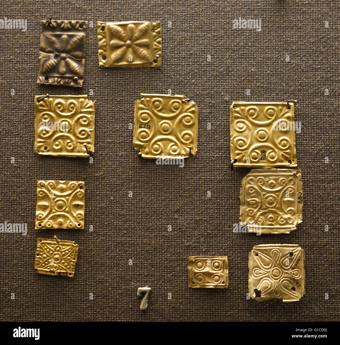 Embossed decorative gold tiles from ancient Greece. - Stock Image