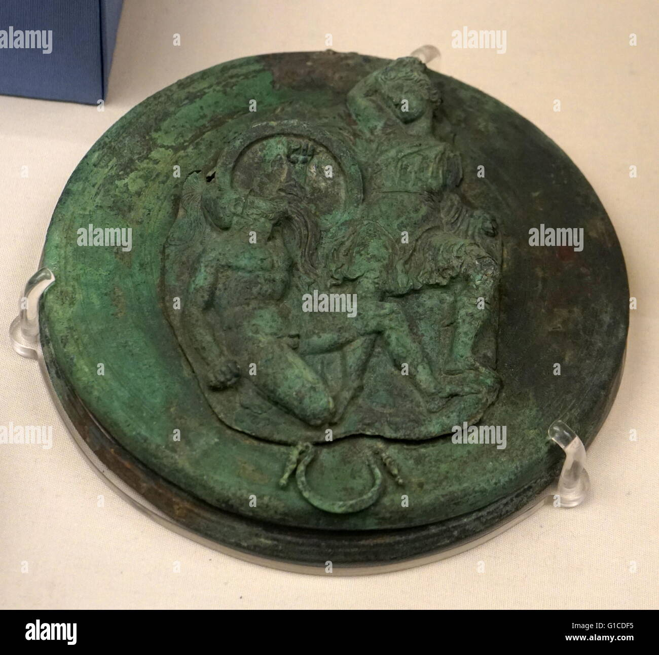 Bronze repousse relief depicting a Nike sacrificing a bull. Dated 350 BC - Stock Image