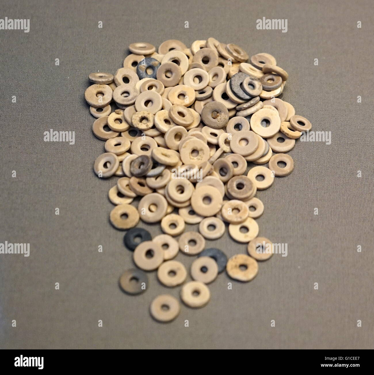 Beads that have been smoothed and polished by rubbing against a block of sandstone. - Stock Image