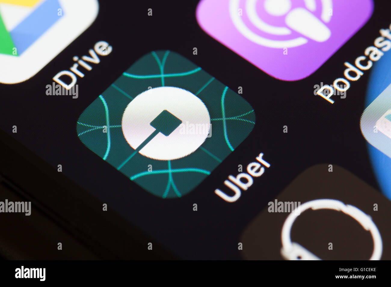 Uber app icon on mobile phone. - Stock Image