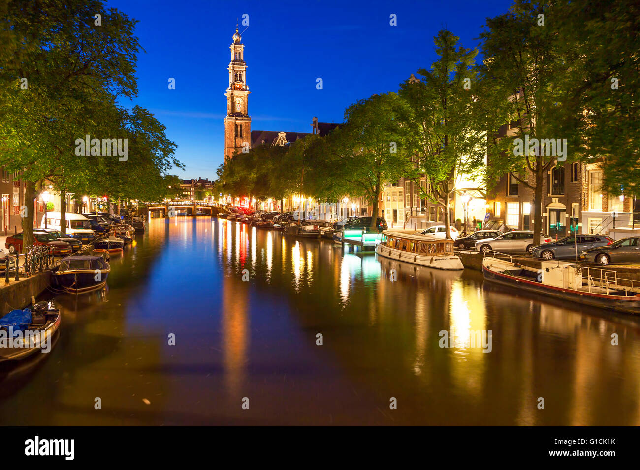 Western church reflecting in water of Prinsengracht canal in Amsterdam - Stock Image