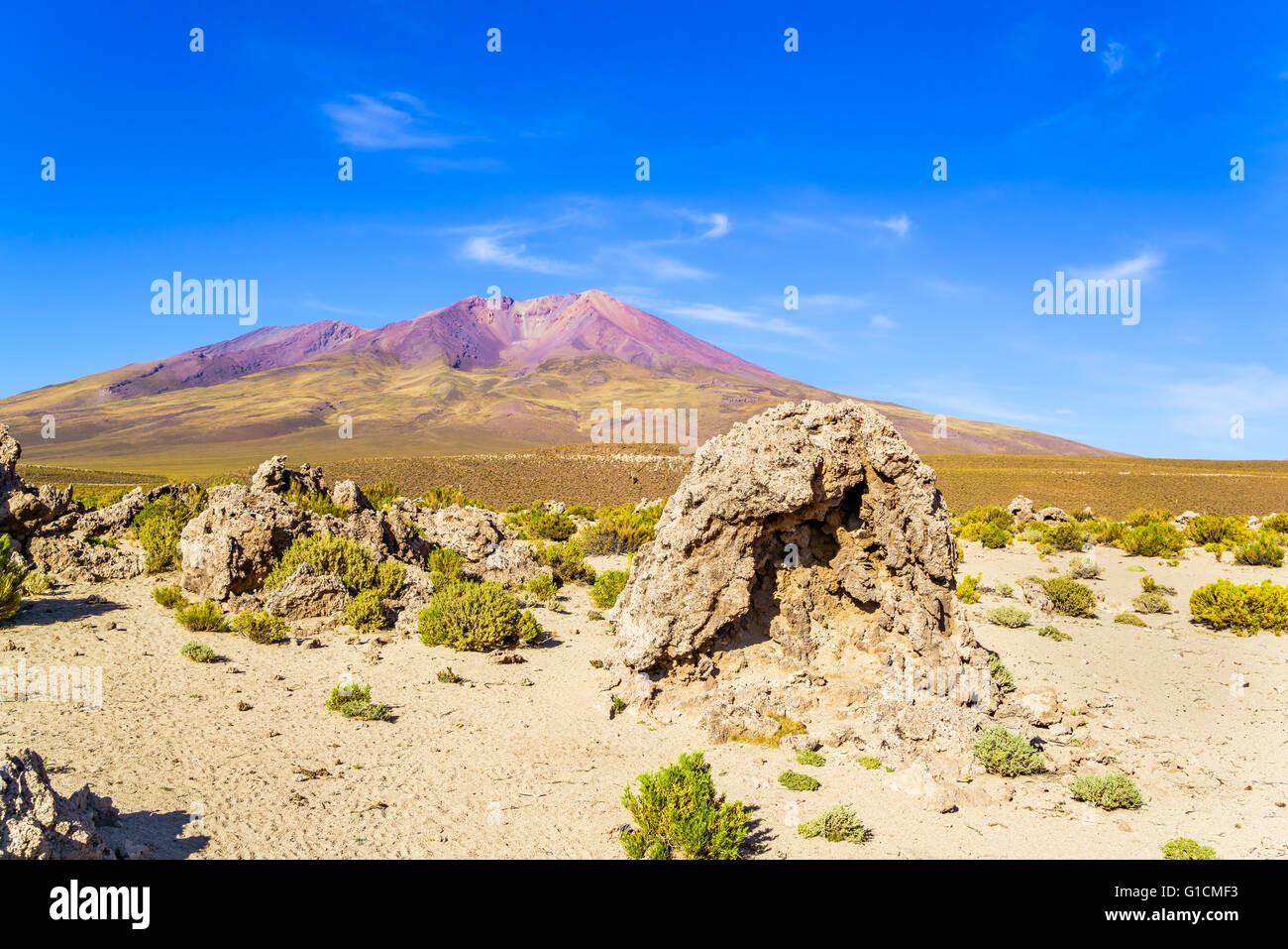 View of dormant volcano and desert in National Park, Uyuni, Bolivia - Stock Image