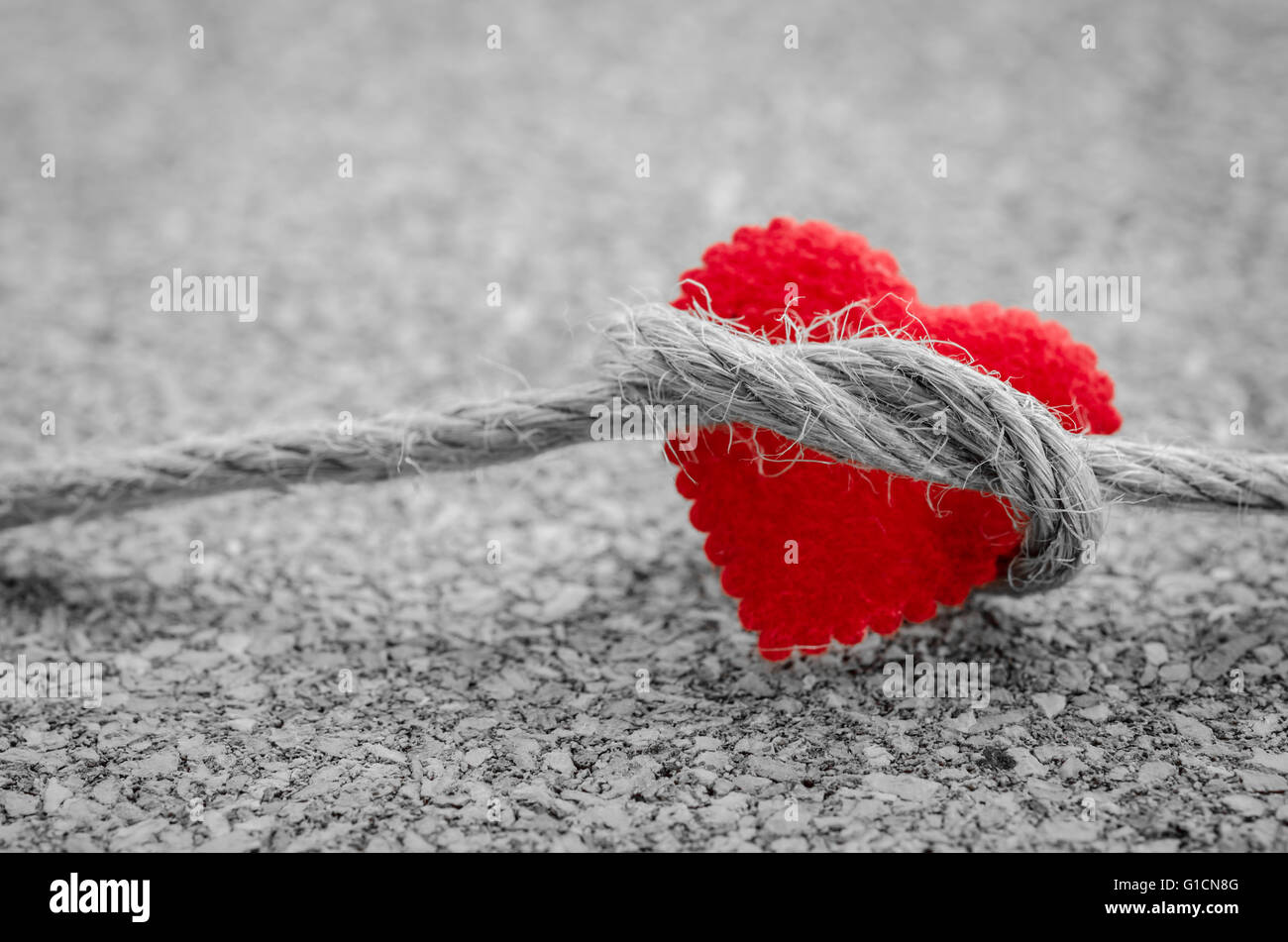 Red heart with a bundle rope on a black and white color