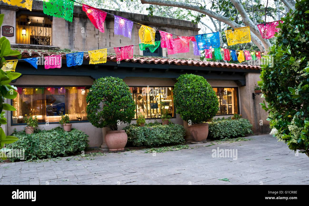 Artisan stores of Tlaquepaque arts and crafts shopping village, Sedona, Arizona.  Decorated for Cinco de Mayo festivities. - Stock Image