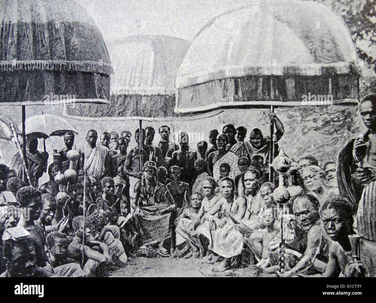 Engraving depicting an African Chief seated in State among his Headmen. Dated 19th Century Stock Photo