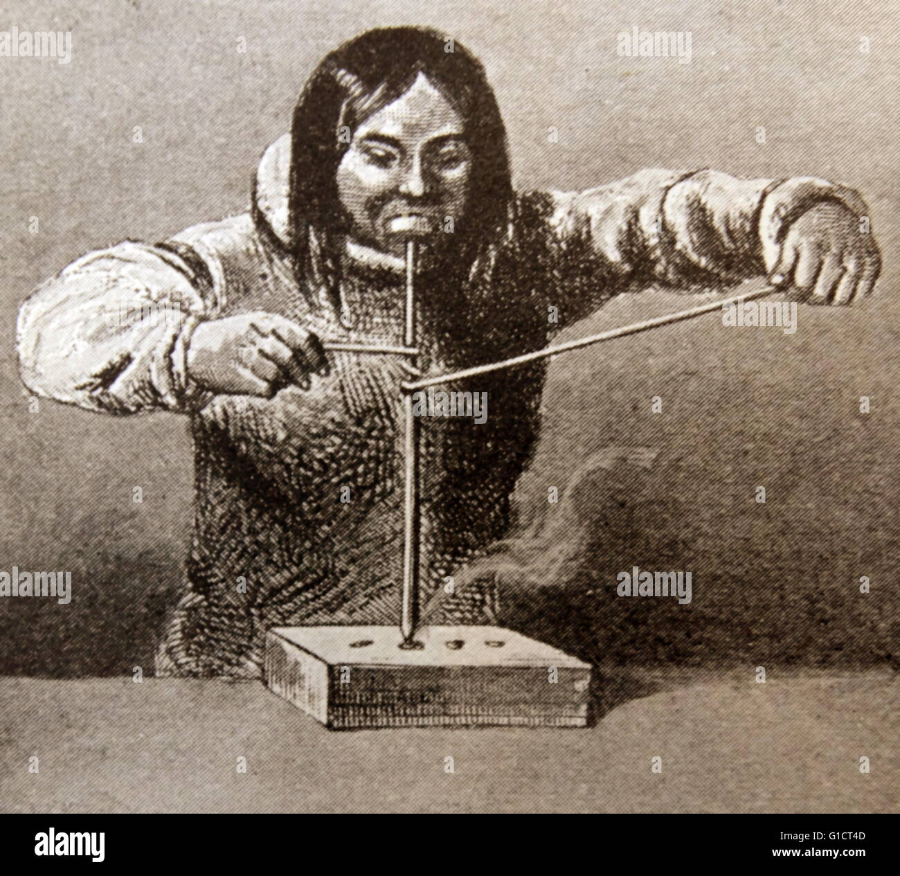 Engraving depicting an Inuit making fire by friction. Dated 19th Century - Stock Image