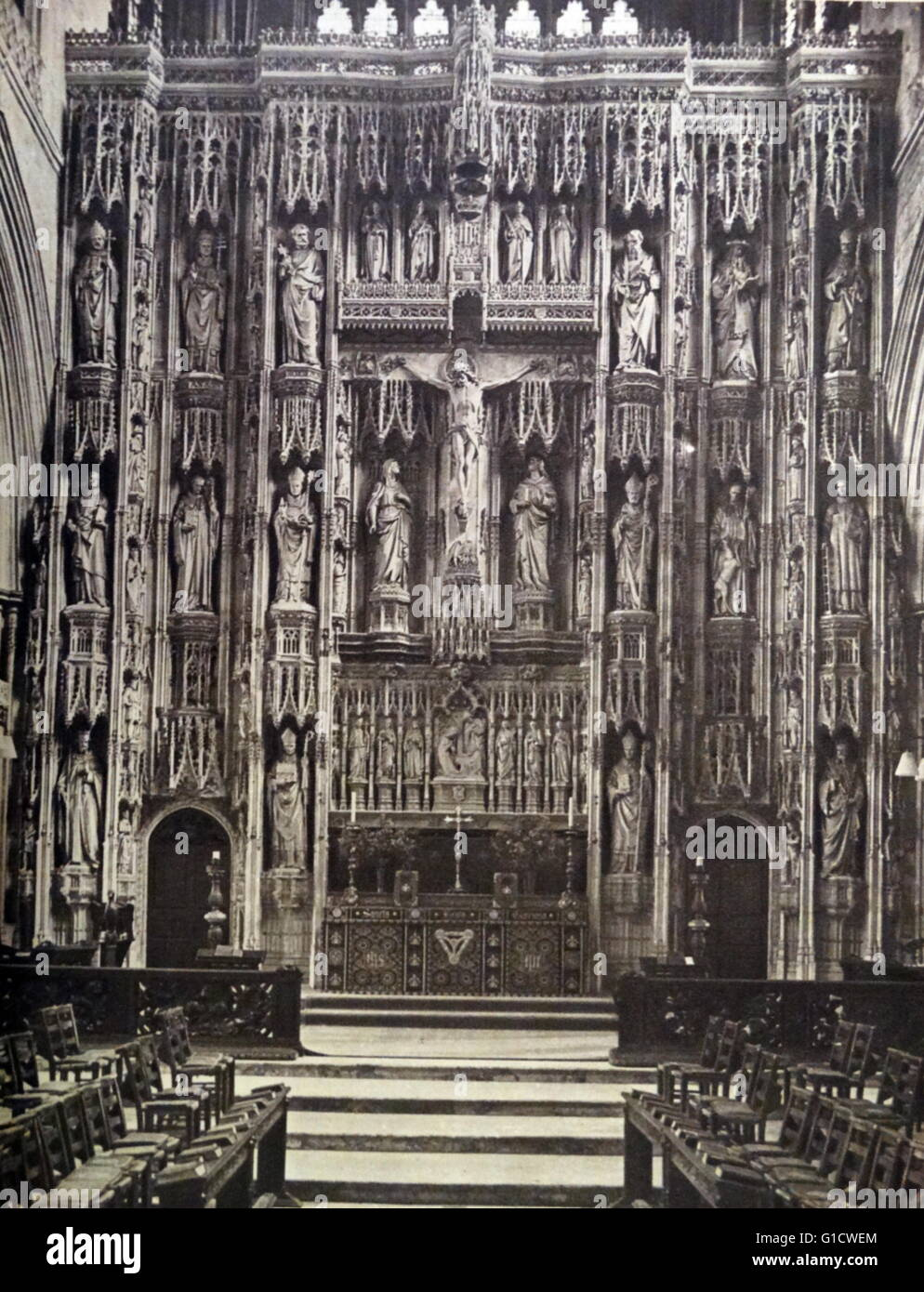 Photographic print of a stone reredos. A reredos is an altarpiece, or a screen or decoration behind the altar in - Stock Image