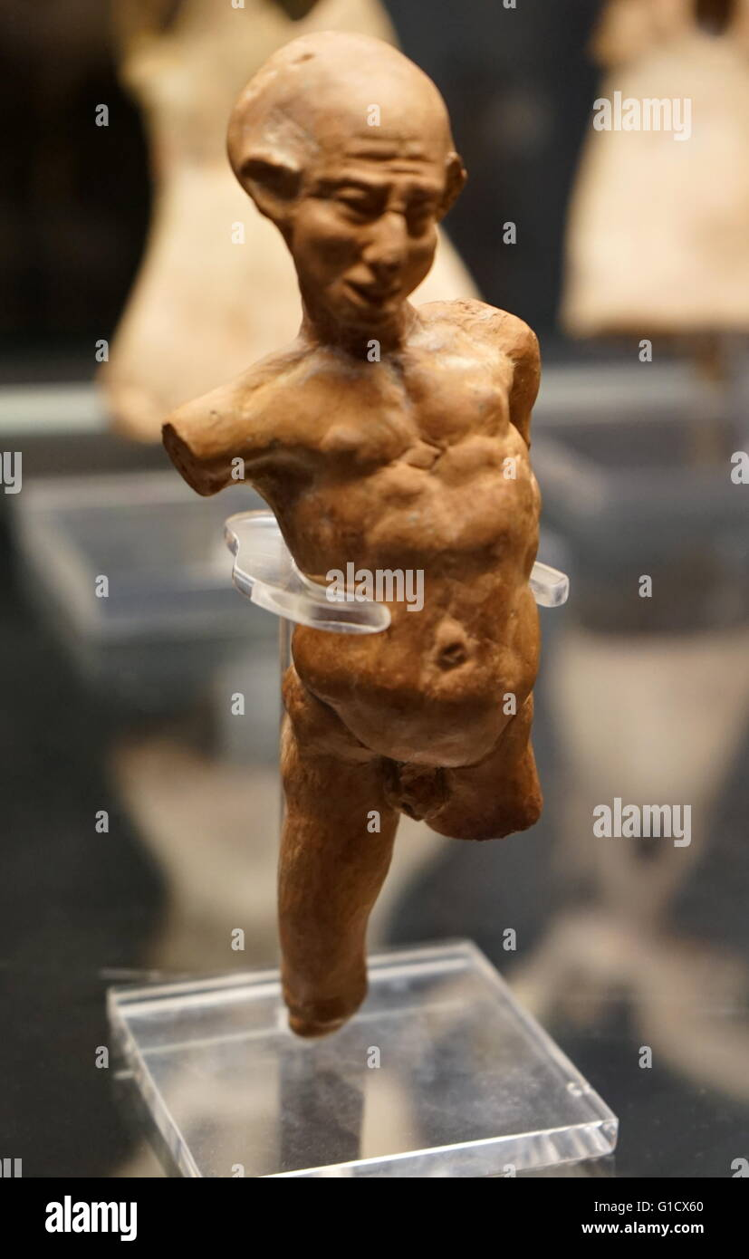 Terracotta figure of a grotesquely deformed and twisted man. Dated 1st Century BC - Stock Image
