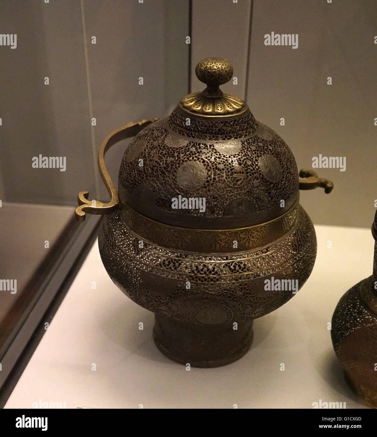 patinated brass vessel in openwork with cast handles, from Iran. Dated 19th Century - Stock Image
