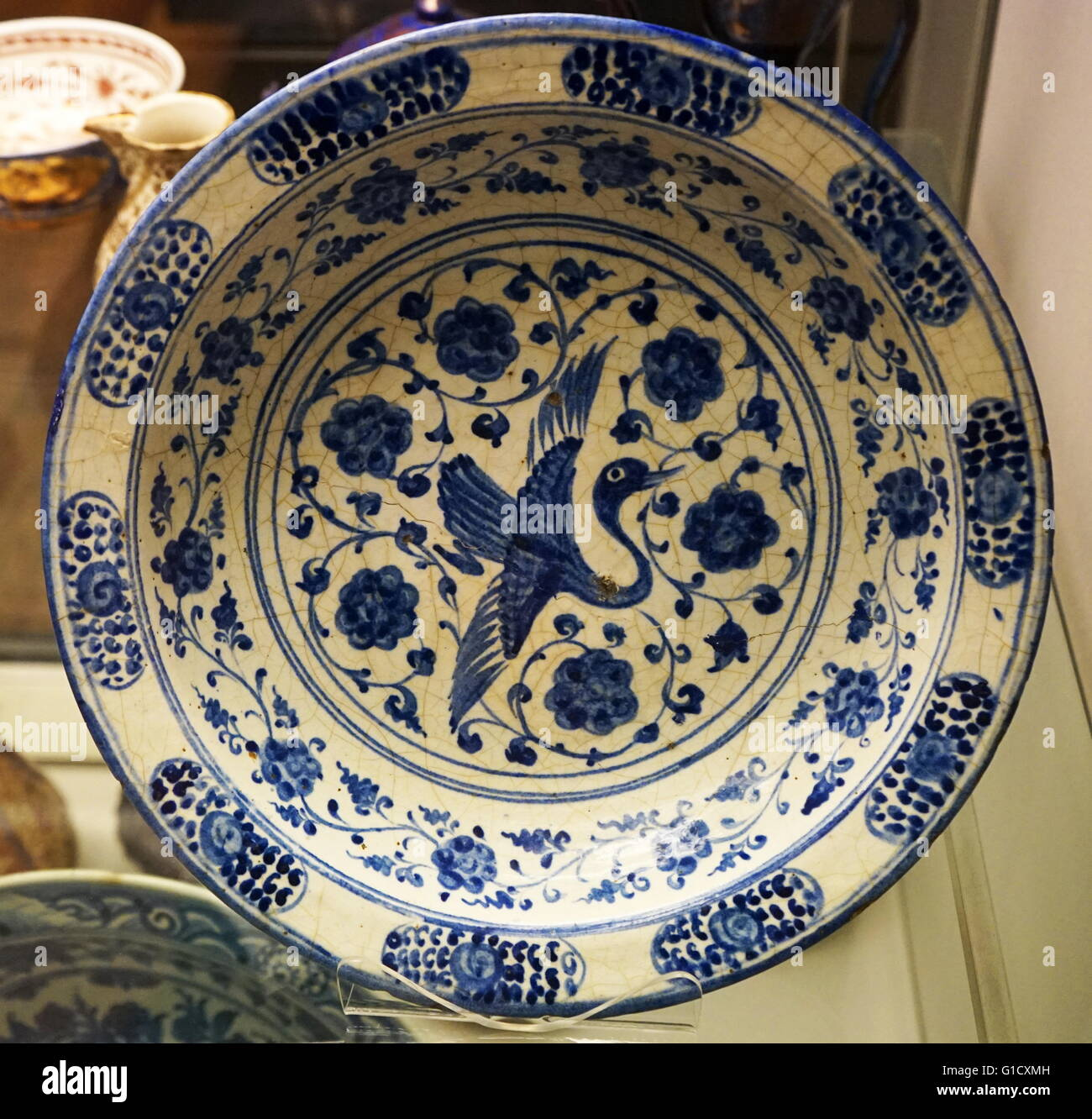 Dish with flying crane and arabesque design, from Iran. Dated 16th Century - Stock Image