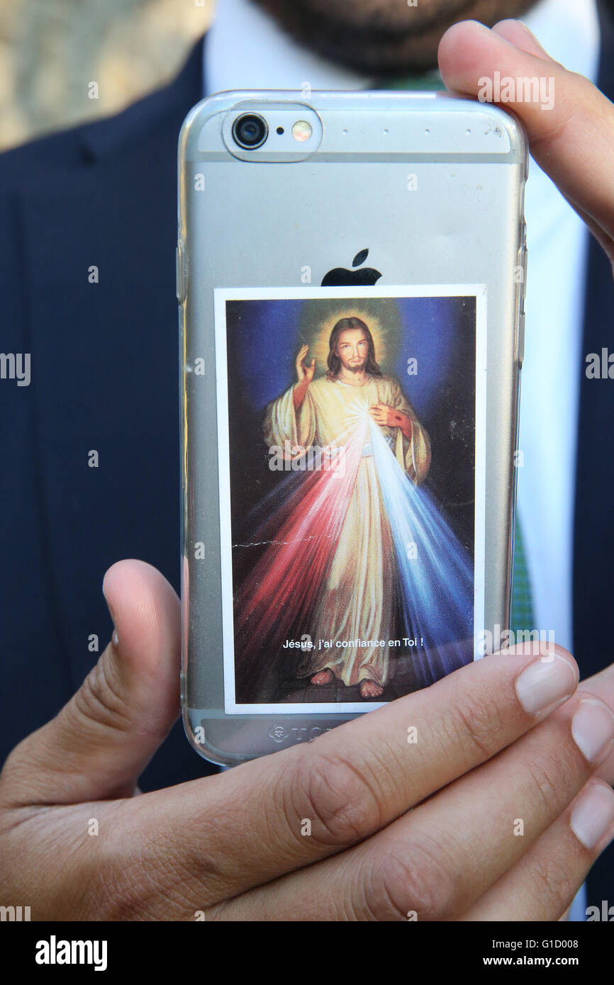 Jesus on an Iphone. France. - Stock Image