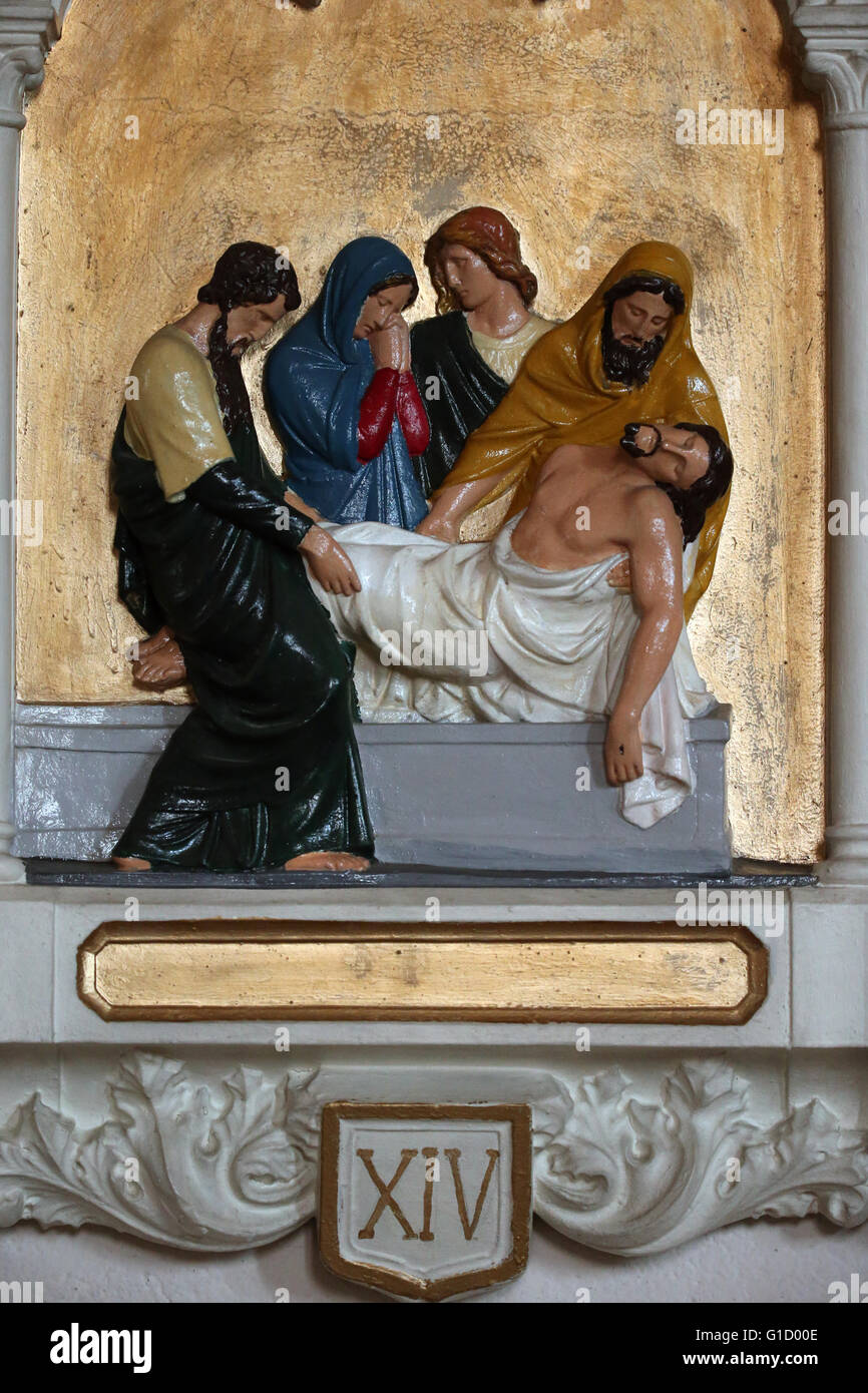 Way of the cross. Station 14. Jesus is laid in the tomb. AmbŽrieux-en-Dombes. France. - Stock Image