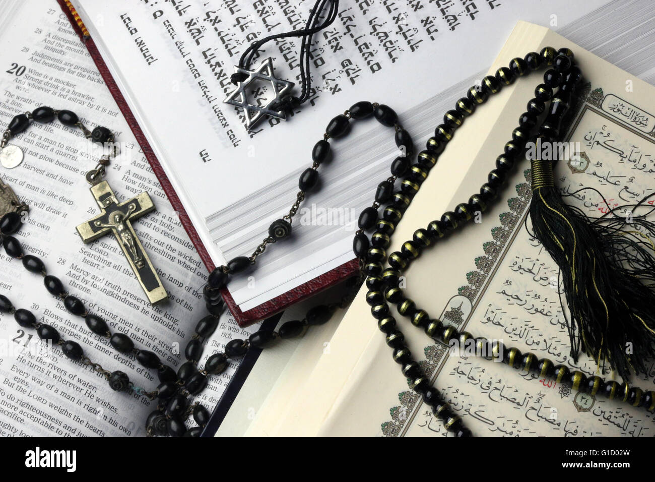 Christianity, Islam and Judaism : 3 monotheistic religions. Bible, Quran and Bible. Interfaith symbols.  France. - Stock Image