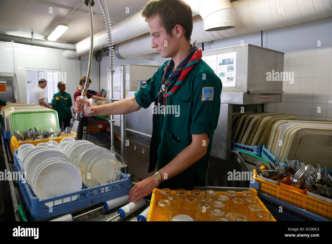 FRAT catholic youth camp. Scout doing the washing-up. Jambville. France. - Stock Image